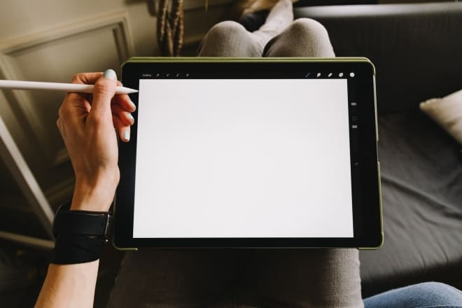 person holding ipad with pencil